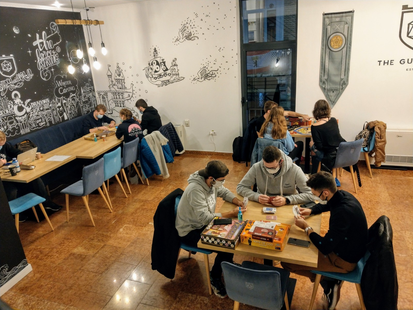 people playing board games at The Guild Hall